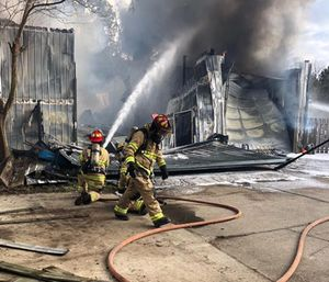 A Central firefighter became trapped when an overhang roof collapsed while crews were working a house fire Monday afternoon. (Photo/Central Fire Dept.)