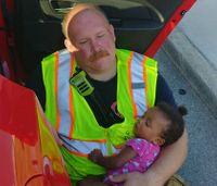 Viral photo shows fire captain comforting child after call