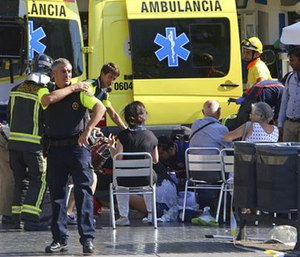 Injured people are treated in Barcelona, Spain, Thursday, Aug. 17, 2017 after a white van jumped the sidewalk in the historic Las Ramblas district. (Photo/AP)