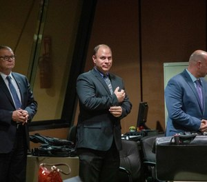 Former Detective David March, from left, Chicago Police Officer Thomas Gaffney and former officer Joseph Walsh appear at a pre-trial hearing with Judge Domenica A. Stephenson at Leighton Criminal Court Building in Chicago on Tuesday, Oct. 30, 2018. Prosecutors have laid out their case against the three Chicago police officers accused of participating in a cover-up of the fatal shooting of Laquan McDonald. (Zbigniew Bzdak/Chicago Tribune via AP, Pool)