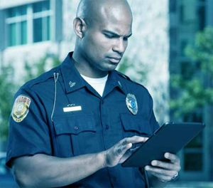 How does a training manager for a police department influence personnel to engage in the online system? (Photo/iStock)