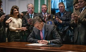 Gov. Charlie Baker signed Senate Bill 2633, which requires departments to have crisis intervention services to prevent PTSD in first responders who are dealing with psychological trauma. (Photo/Gov. Charlie Baker)