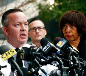 In this Nov. 16, 2017 file photo, Baltimore Police Department Commissioner Kevin Davis, left, speaks alongside Mayor Catherine Pugh at a news conference outside the R Adams Cowley Shock Trauma Center in Baltimore. (AP Photo/Patrick Semansky, File)