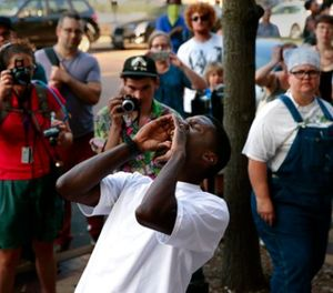 State Rep. Bruce Franks chants in front of the Buzz Westfall Justice Center as more than a hundred people wait for the release of almost two dozen people arrested earlier in the day at the Saint Louis Galleria mall, Saturday, Sept. 23, 2017, in Clayton, Mo. (Robert Cohen/St. Louis Post-Dispatch via AP)