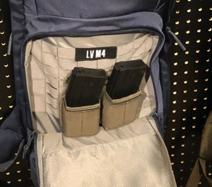 MOLLE-compatible gear, such as mag pouches, can be attached inside the M4 pack. (Photo/Ron LaPedis)