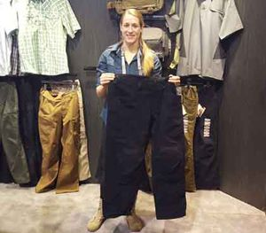 Lyndsey Grove — Marketing Campaign Manager for 5.11 Tactical — holds the XPRT Uniform pants, which feature 16 pockets, magnetic closures, and a patch of Kevlar sewn into the crotch. (PoliceOne Image)