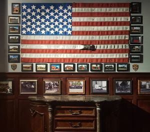 The business aims for a refined feel, with abundant wall decor featuring art, police and fire department memorabilia collected by the owners and donated by passionate members of the community. (Photo/Buffalo Station House)