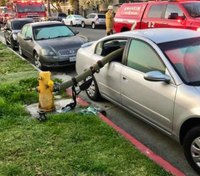 Calif. fire dept. defends viral photo of hose through car window