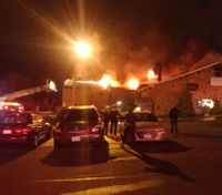 Off-duty firefighter evacuates 200 when building catches fire