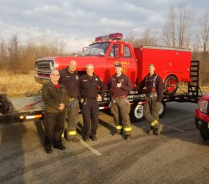 """A small group from the Danbury (Connecticut) Fire Department poses with a replica truck from the hit TV show """"Emergency!"""" (Photo/Danbudy FD Facebook)"""