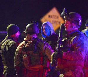 SWAT team members prepare to search the neighborhood where a police officer was fatally shot Friday, Nov. 17, 2017, in New Kensington, Pa. (Rebecca Droke/Pittsburgh Post-Gazette via AP)