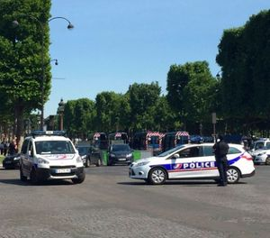 Police vehicles prevent the access to the Champs Elysees avenue in Paris, France, Monday, June 19, 2017. (AP Photo/Bertrand Combaldieu)