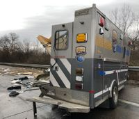 7 hurt after concrete truck crashes into back of ambulance