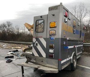 A concrete pumping truck crashed into an ambulance while an EMS crew was pulled over trying to calm a patient, according to officials. (Photo/LEMS)