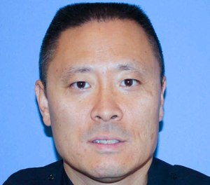 In this undated file photo provided by the Cincinnati Police Department shows Officer Sonny Kim. (Cincinnati Police Department via AP)