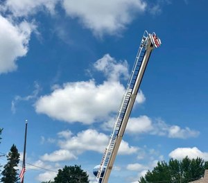 The Waterville Fire Department honored Potter by raising a flag from a ladder on one of the engines. (Photo/Waterville Fire Department)