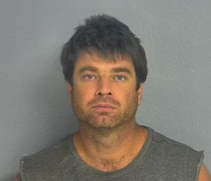 Police said Jason Hawkins lit his own home on fire in an effort to get revenge on a firefighter who was dating his ex-wife. (Photo/Greene County Sheriff's Office)