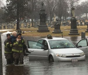 Firefighters saved two elderly women from knee-deep floodwaters after their car stalled in a deep puddle. (Photo/Springfield Fire Department)