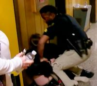 Video: Teacher who questioned pay raise arrested at school board meeting