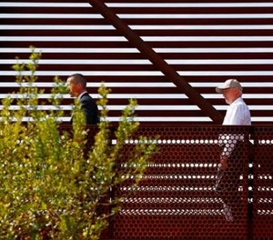 Attorney General Jeff Sessions, center, tours the U.S.-Mexico border with border officials, Tuesday, April 11, 2017, in Nogales, Ariz. (AP Photo/Ross D. Franklin)
