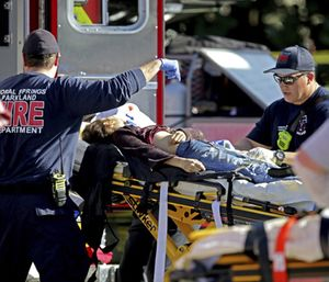 The Coral Springs Fire Department is shown treating a patient after a shooting at Marjory Stoneman Douglas High School. (Photo/AP)
