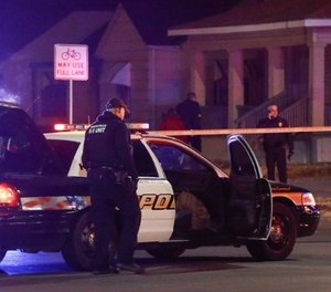 """Wichita police investigate a call near the corner of McCormick and Seneca in Wichita, Kan. Thursday night 12/28. A man was fatally shot by a police officer in what is believed to be a """"swatting"""" call. (Fernando Salazar /The Wichita Eagle via AP)"""