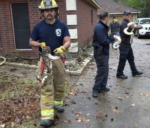 Firefighters in Texas have rescued more than 100 snakes from a home that caught fire. (Photo/AP)