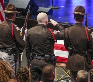 LEOs salute the casket of Boone County Deputy Jacob Pickett during his funeral service at Connection Pointe Christian Church in Brownsburg, Ind., Friday, March 9, 2018. (Kelly Wilkinson/The Indianapolis Star via AP)