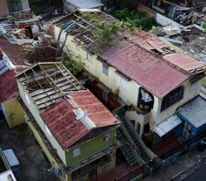 In this Nov. 15, 2017 photo, some roofs damaged by the whip of Hurricane Maria are shown still exposed to rainy weather conditions, in San Juan, Puerto Rico. (AP Photo/Carlos Giusti)