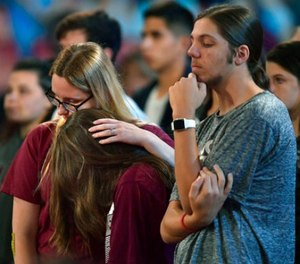 Marjory Stoneman Douglas High School students listen to sheriff Scott Israel speak before a CNN town hall broadcast, Wednesday, Feb. 21, 2018, at the BB&T Center, in Sunrise, Fla. (Michael Laughlin/South Florida Sun-Sentinel via AP)