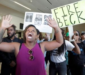 In this Oct. 3, 2016, file photo, protesters demand the firing of Los Angeles Police Chief Charlie Beck over a police-involved shooting of a black man over the weekend during a news conference at LAPD headquarters in Los Angeles. A civilian oversight board has found Tuesday, Aug. 15, 2017, that Los Angeles police officers acted within policy in the fatal shooting of an 18-year-old man that sparked several Black Lives Matter protests. (AP Photo/Nick Ut, file)