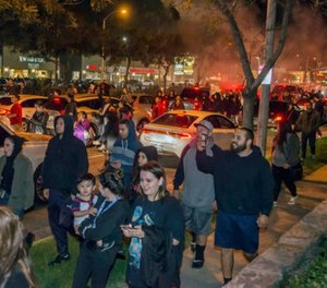 Protesters then took to Euclid Street, blocking traffic and marching north toward Ball Road, where they congregated in the intersection for several minutes in Anaheim, Calif., Wednesday, Feb. 22, 2017. (Joshua Sudock/The Orange County Register via AP)