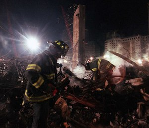 """Firefighters from Staten Island's Rescue 5 company search for victims in the """"pile"""" at Ground Zero. (Photo/Los Angeles Times/MCT)"""