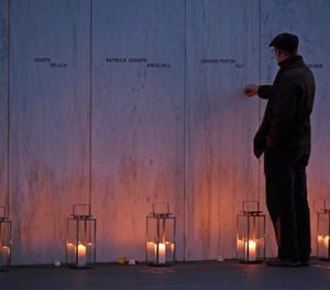 A man pays his respects at the Wall of Names at the United Flight 93 National Memorial in Shanksville, Pa., Saturday, Sept. 10, 2017. (AP Photo/Fred Vuich)