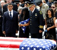 Mourners remember Houston officer lost to Harvey's floods
