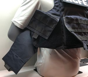 """New body armor products on display included the Hardcore FE from Armor Express, which comes with or without MOLLE panels and has what the company calls a """"dynamic armored cummerbund."""" (Photo/Ron LaPedis)"""