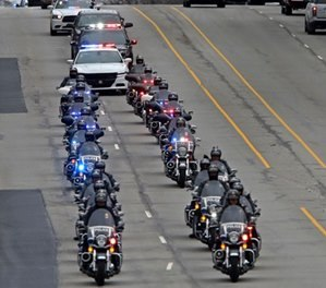 "A long line of IMPD, Sheriff, and State Police officers escort the body of Boone Co. sheriff's deputy Jacob ""Jake"" Pickett, Monday, Mar. 5, 2018. (Kelly Wilkinson/The Indianapolis Star via AP)"