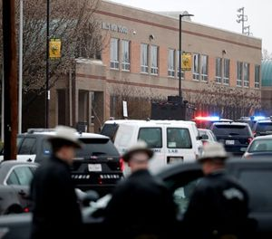 "Deputies and federal agents converge on Great Mills High School, the scene of a shooting, Tuesday morning, March 20, 2018 in Great Mills, Md. The shooting left three people injured including the shooter. Authorities said the situation was ""contained."" (AP Photo/Alex Brandon )"