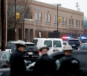 """Deputies and federal agents converge on Great Mills High School, the scene of a shooting, Tuesday morning, March 20, 2018 in Great Mills, Md. The shooting left three people injured including the shooter. Authorities said the situation was """"contained."""" (AP Photo/Alex Brandon )"""