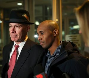 Former Minneapolis Police Officer Mohamed Noor leaves the Hennepin County Public Safety Facility with his attorney, Thomas Plunkett, left, after posting bail Wednesday night, March 21, 2018, in Minneapolis. (Jeff Wheeler/Star Tribune via AP)