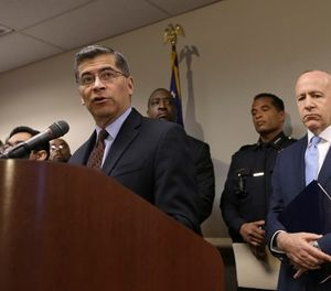 California Attorney General Xavier Becerra, left, discusses his office's involvement of an investigation into the killing of Stephon Clark by two Sacramento Police officers, Tuesday, March 27, 2018, in Sacramento, Calif. (AP Photo/Rich Pedroncelli)