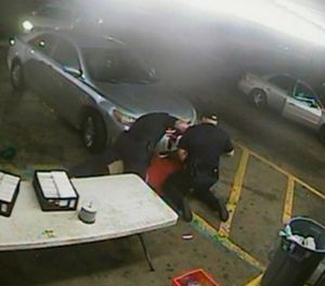 In this still image taken from security camera video provided Friday, March 30, 2018, by the Baton Rouge Police Department, officers Blane Salamoni and Howie Lake II confront Alton Sterling during a struggle outside the Triple S Food Mart in Baton Rouge, La., in July 2016. (Courtesy of Baton Rouge Police Department via AP)