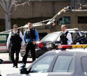 Armed law enforcement personnel exit YouTube headquarters, Tuesday, April 3, 2018, in San Bruno, Calif. A woman opened fire at YouTube headquarters Tuesday, setting off a panic among employees and wounding several people before fatally shooting herself, police and witnesses said. (AP Photo/Marcio Jose Sanchez)