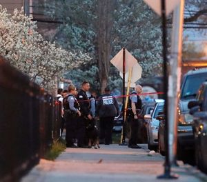Chicago police work the scene near the area where a federal agent was shot and critically wounded in Chicago while working on an investigation with local authorities on Friday, May 4, 2018. (Jose M. Osorio/Chicago Tribune via AP)