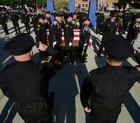 Ind. police officer killed in shootout honored as a hero