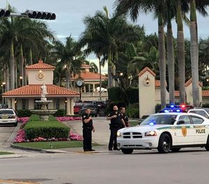 Police respond to The Trump National Doral resort after reports of a shooting inside the resort Friday, May 18, 2018 in Doral, Fla. A man shouting about Donald Trump entered the president's south Florida golf course early Friday, draped a flag over a lobby counter and exchanged fire with police before being arrested, police said. One officer received an unspecified injury, officials said. (AP Photo/Frieda Frisaro)
