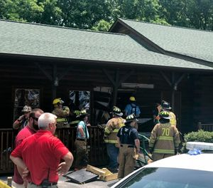 Authorities work the scene of a restaurant where police say a man intentionally rammed a vehicle into the steak and seafood eatery shortly after midday Sunday, May 20, 2018, in Bessemer City, N.C., leaving his 26-year-old daughter and one other person dead and several others injured.  (Kevin Ellis/The Gaston Gazette via AP)