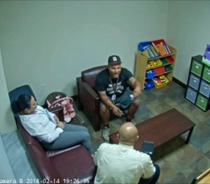 In this Feb. 14, 2018 frame from surveillance video provided by the Broward Sheriff's Office, Andrew Medina, center, is interviewed by detectives following the shooting at Marjory Stoneman Douglas High School in Florida. (Broward Sheriff's Office via AP)