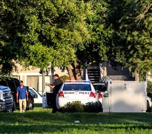 Police continue to work at the scene of a hostage standoff where a police officer was shot Monday morning, June 11, 2018, in Orlando. Police said a man suspected of battering his girlfriend wounded a police officer late Sunday and barricaded himself inside an apartment with several young children. (Jacob Langston/Orlando Sentinel via AP)