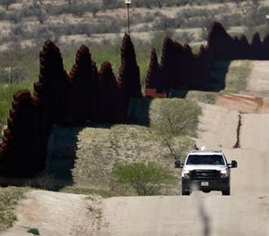 In this April 10, 2018, file photo, a Customs and Border Patrol agent patrols the international border near Nogales, Ariz. The U.S. Border Patrol says an agent has been wounded in a shooting in southern Arizona near the U.S.-Mexico border. (AP Photo/Matt York, file)